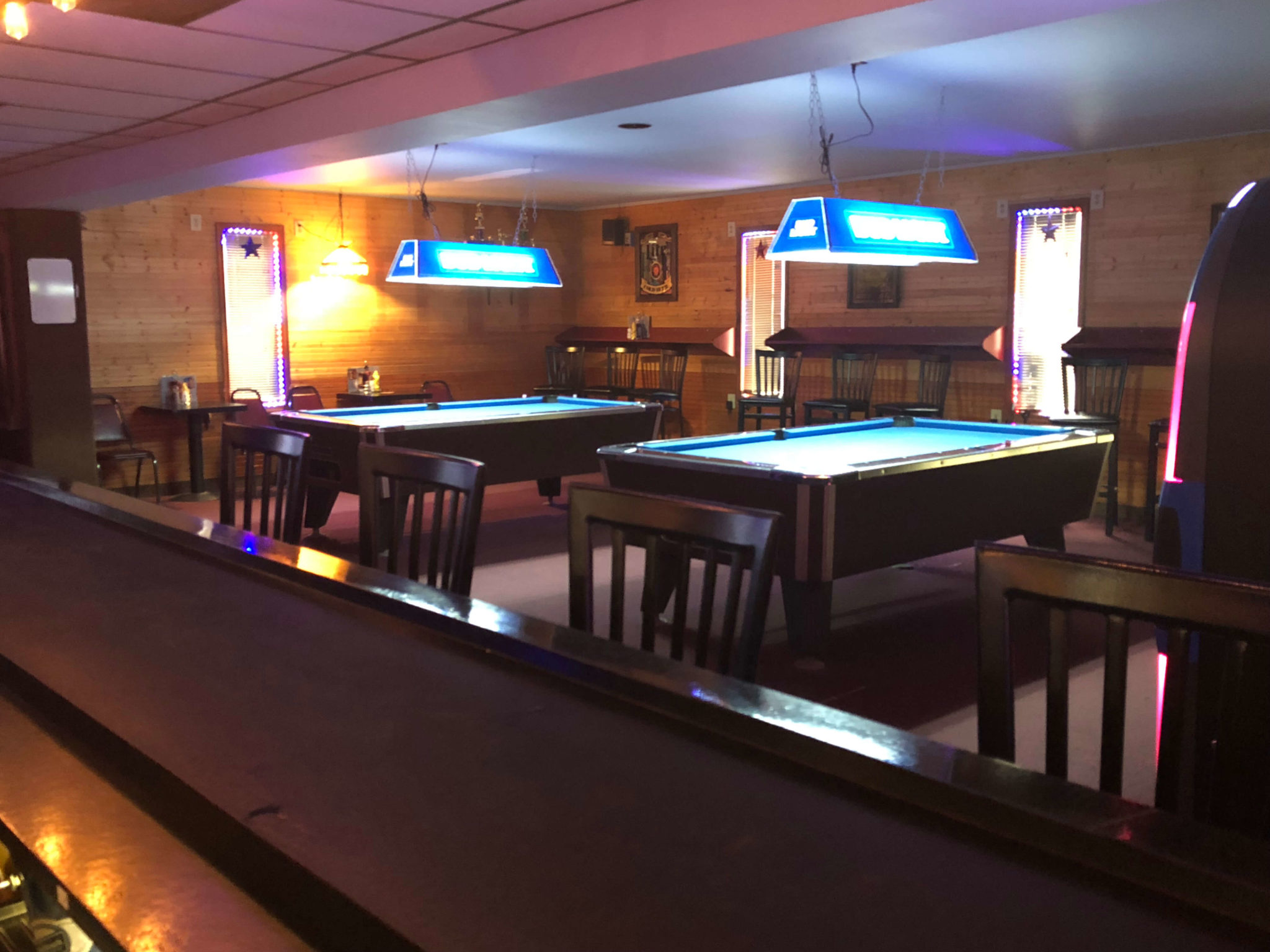Pool tables, bar, bar stools - interior photo of Big Falls Inn in White Marsh, MD